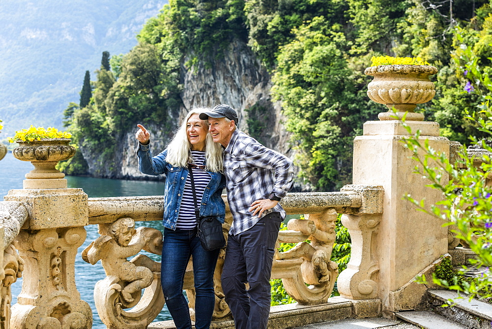 Smiling couple at Villa del Balbianello by Lake Como, Italy