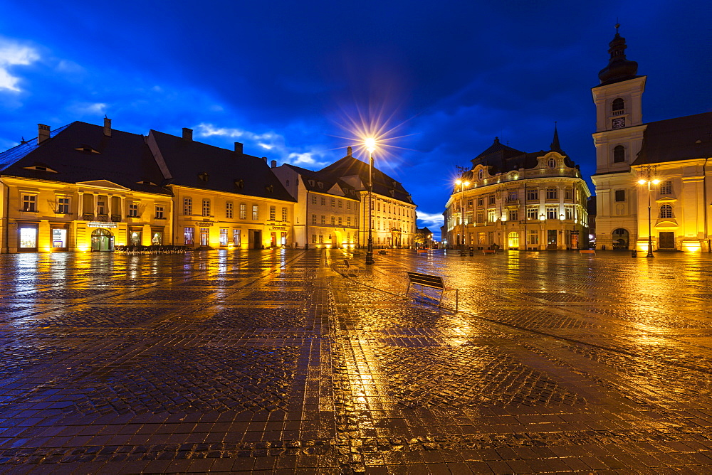 Wet Grand Square at sunset in Sibiu, Romania