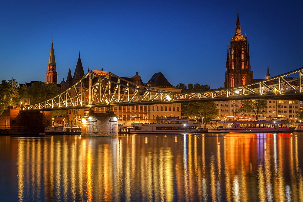 Bridge over river at sunset in Frankfurt, Germany