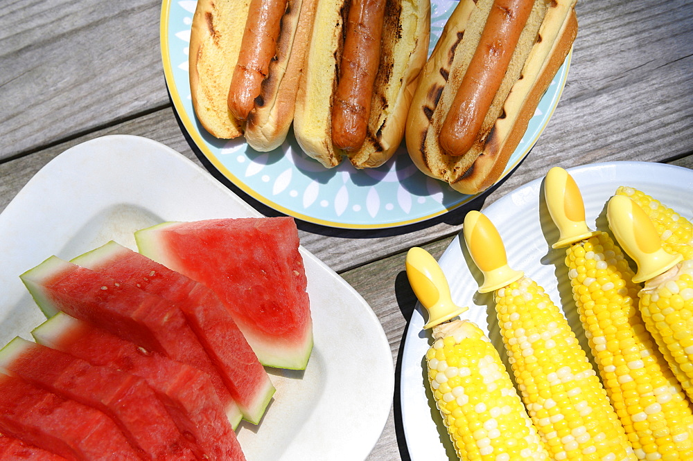 Watermelon, hot dogs and corn cobs
