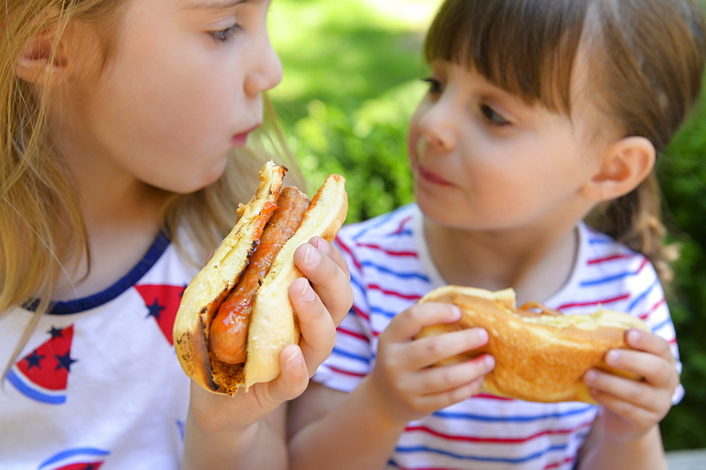 Girls eating hot dogs