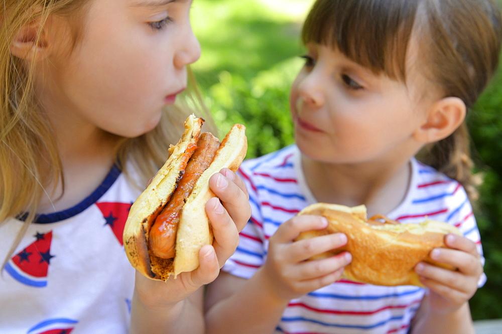 Girls eating hot dogs