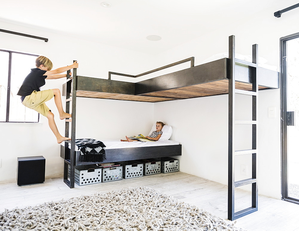 Siblings on bunk beds