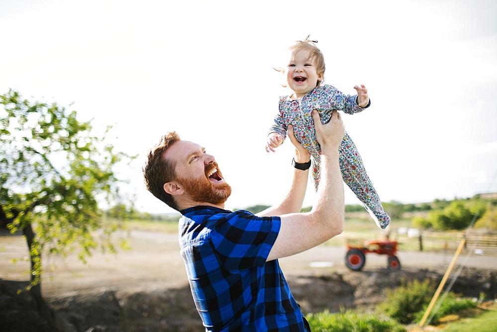 Father lifting baby girl - 1178-27603