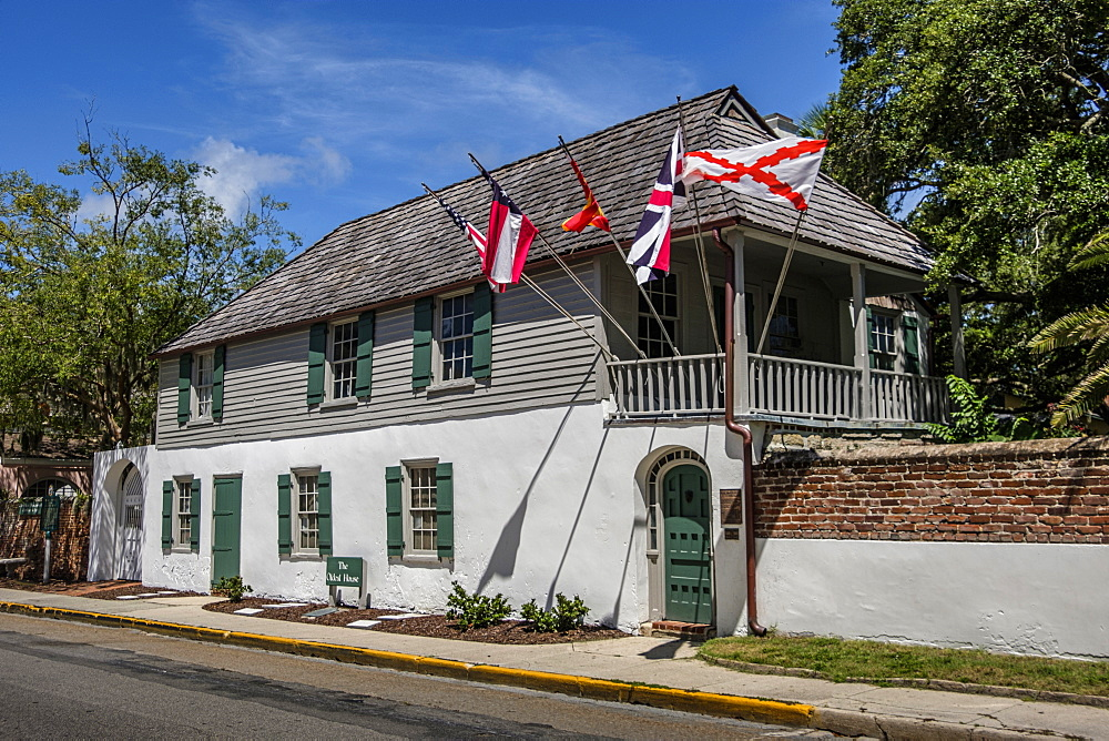 House with multiple flags in St. Augustine, USA