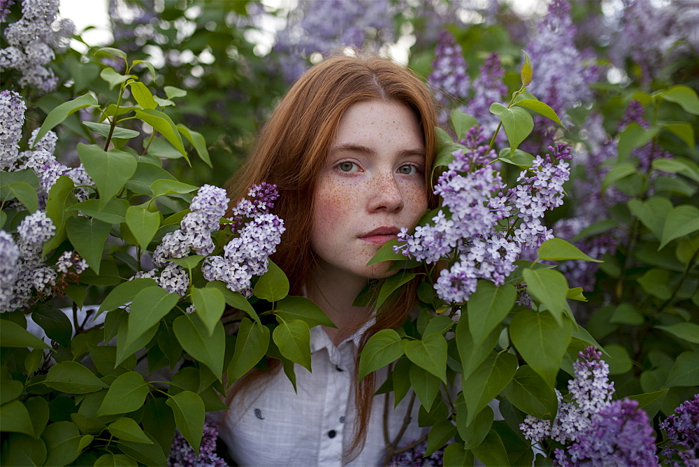Teenage girl among purple flowers