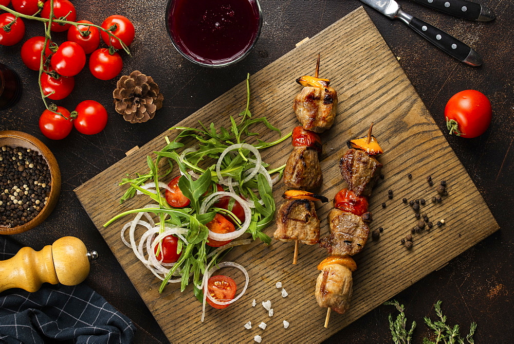 Grilled meat skewers and salad on cutting board - 1178-27748