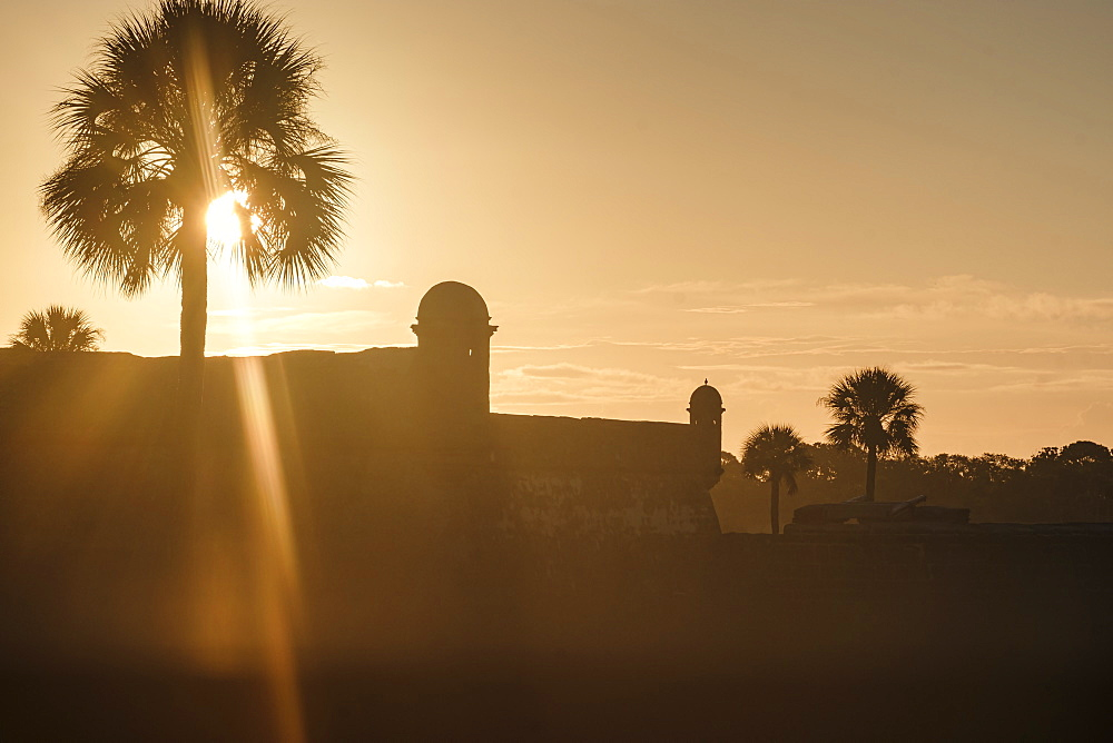 Silhouette of Castillo de San Marcos at sunset in St. Augustine, USA