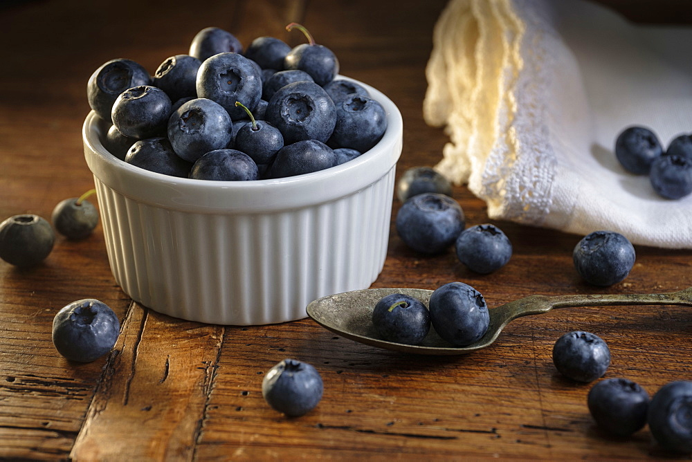 Ramekin of blueberries with spoon