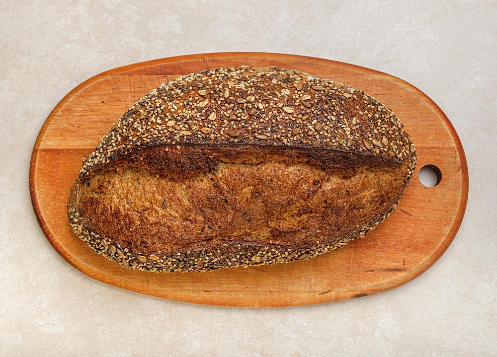 Loaf of bread on cutting board