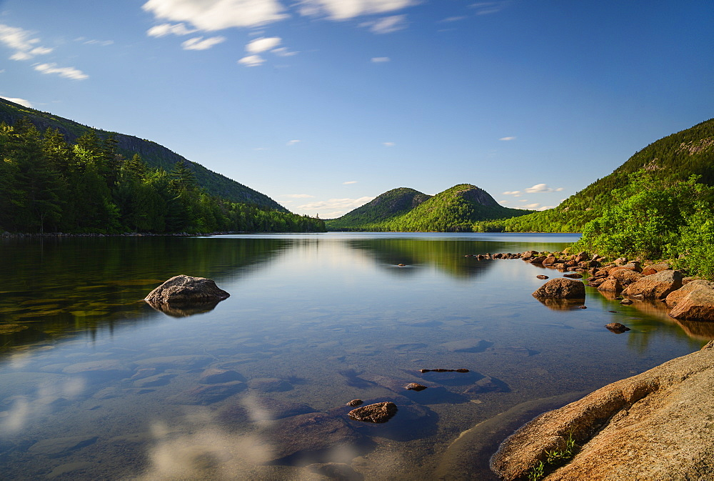 Rocks in Jordan Pond by hills in Acadia National Park, Maine, USA