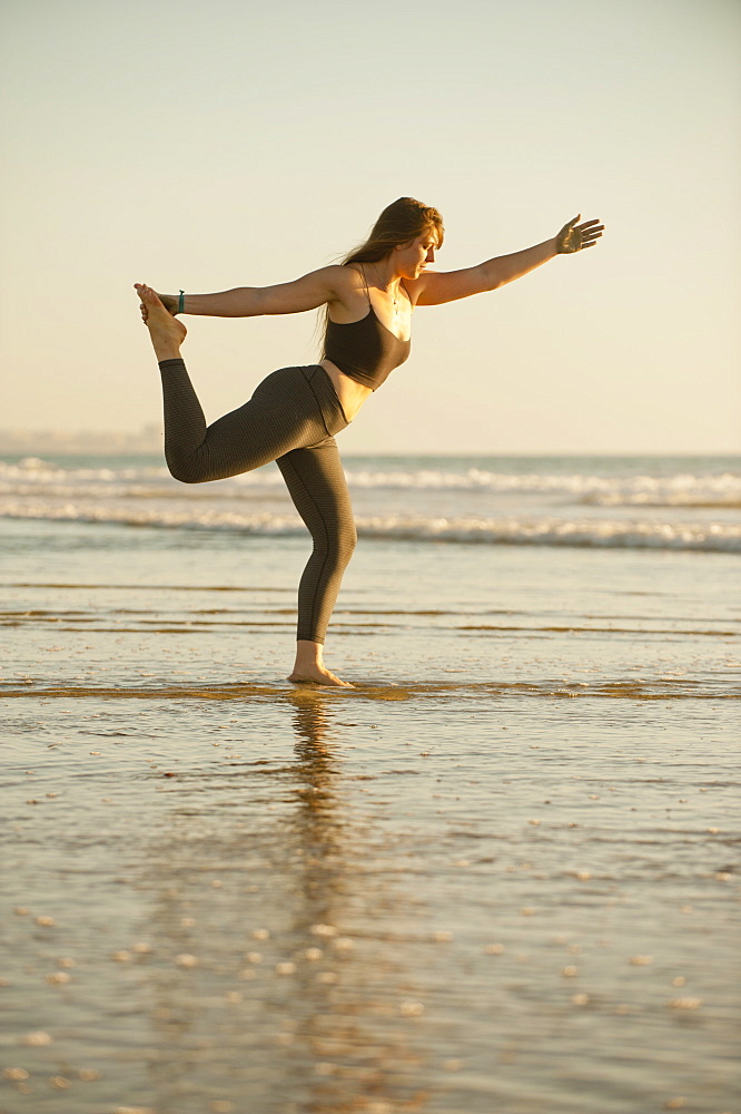 Young woman doing yoga on beach - 1178-27883