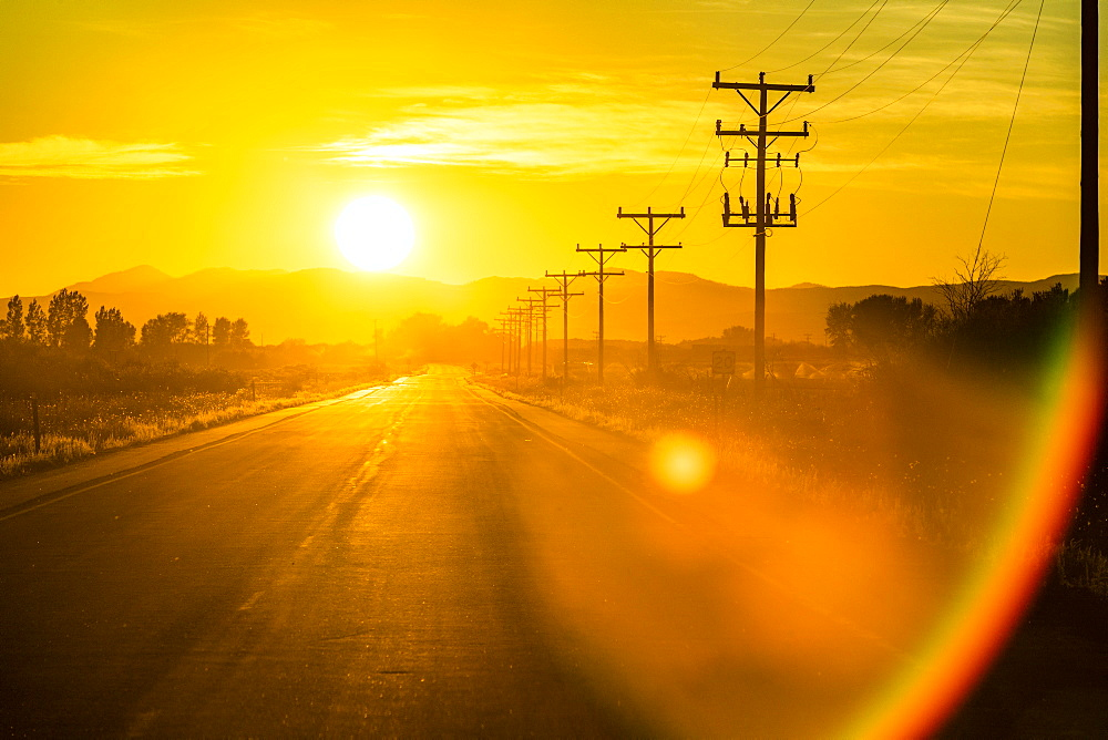 Sunset over country road in Picabo, Idaho, USA