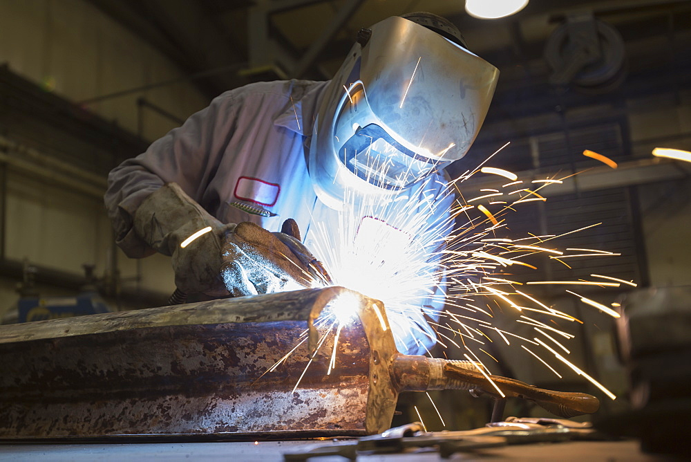 Man welding with sparks flying