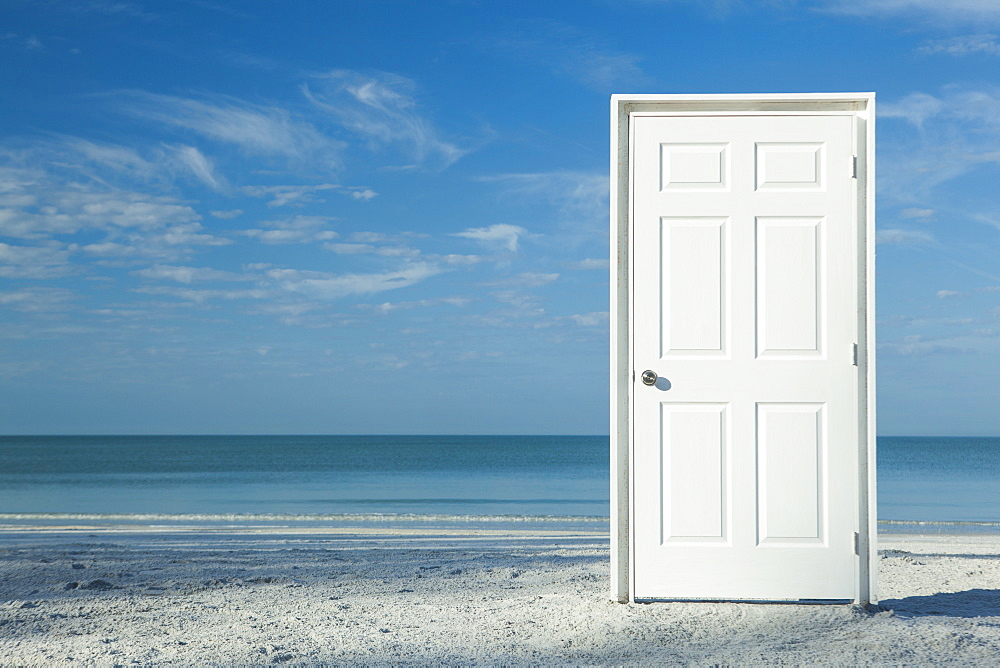 White door on beach