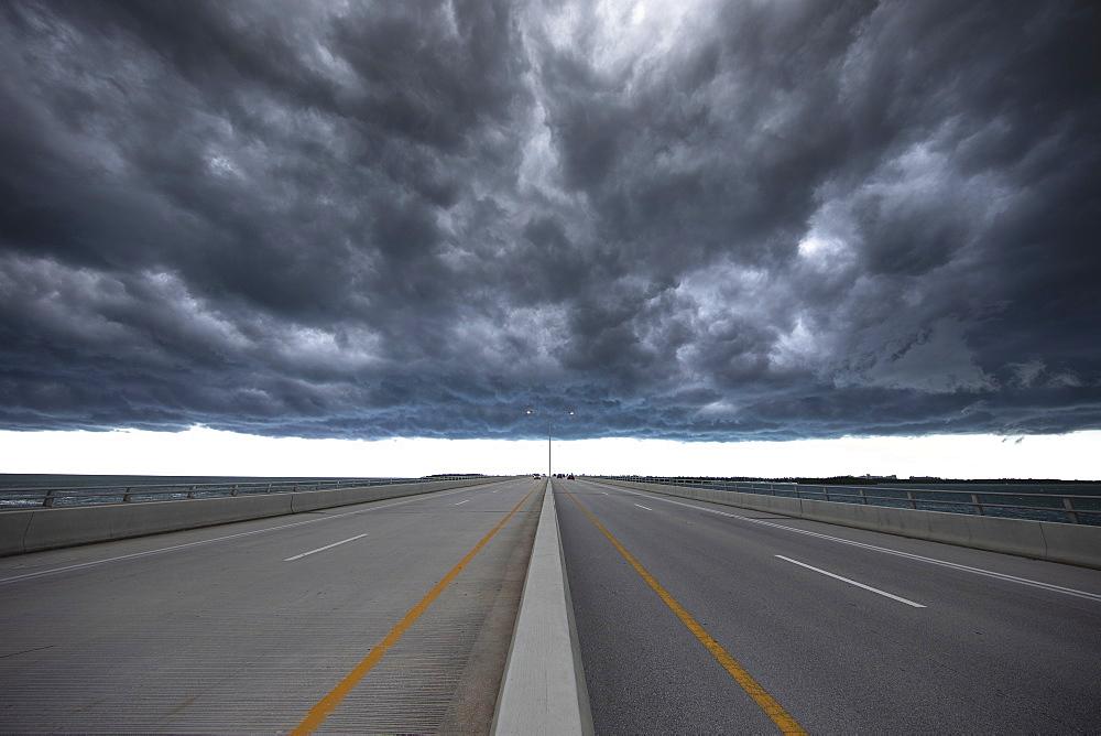 Road under stormy sky