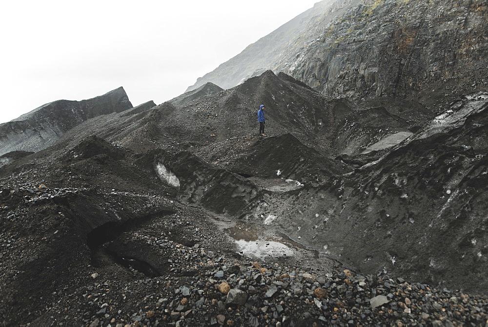 Man walking on rock in Skaftafell, Iceland