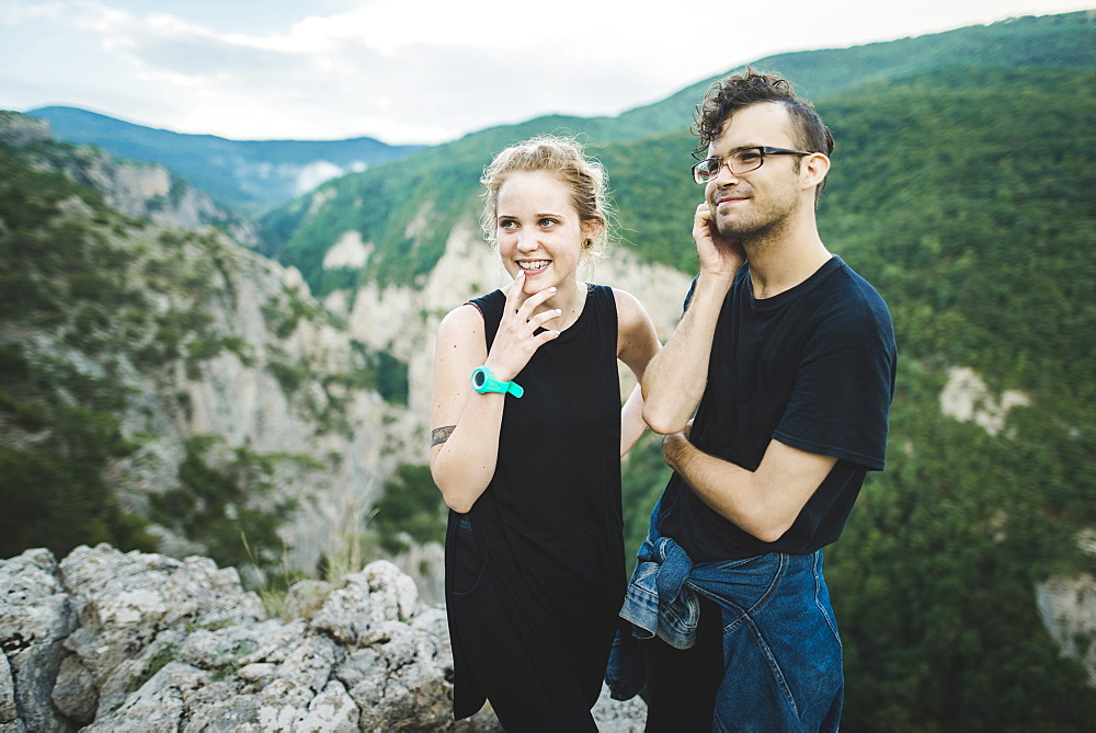 Smiling couple by mountains in Crimea, Ukraine