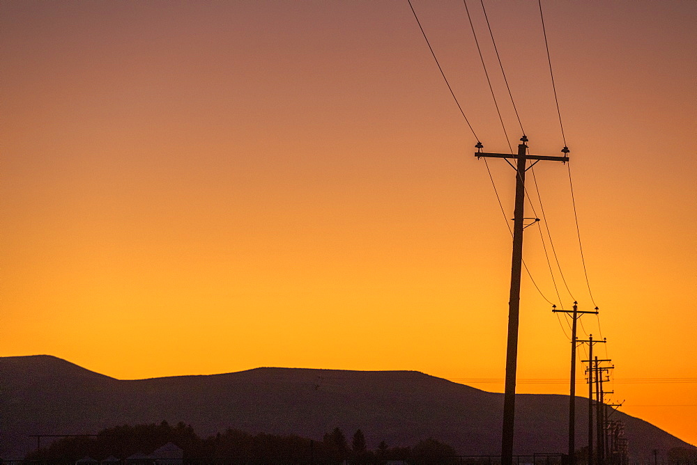 Silhouette of power lines and hill at sunset in Picabo, Idaho, United States of America