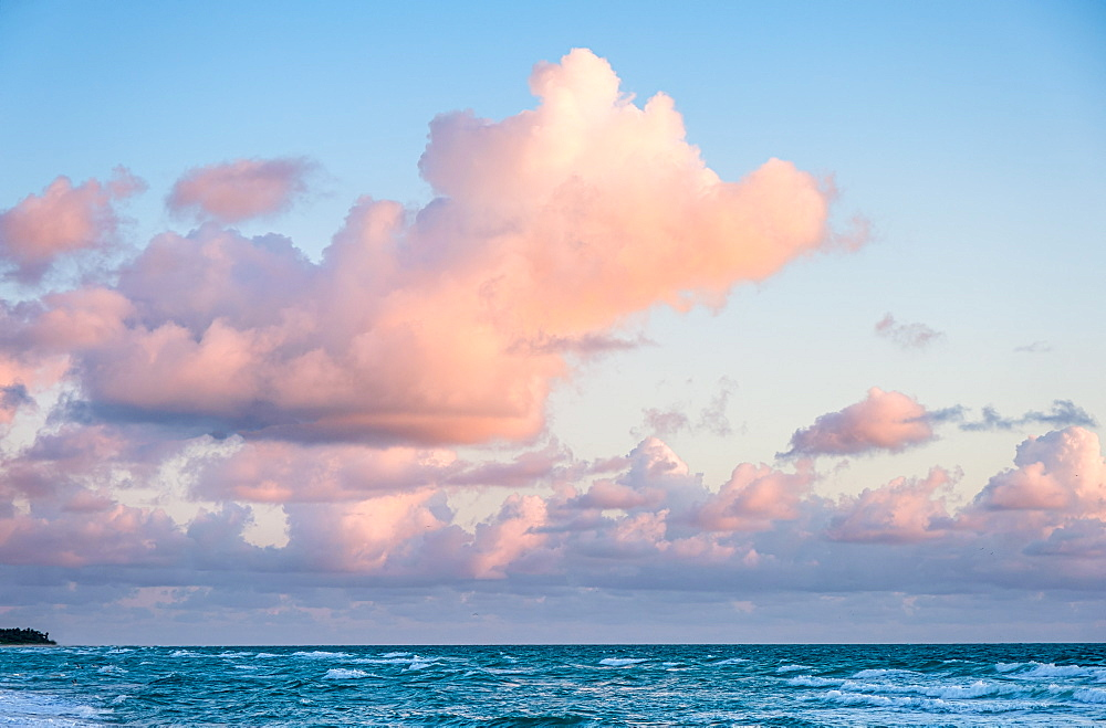 Pink clouds over sea