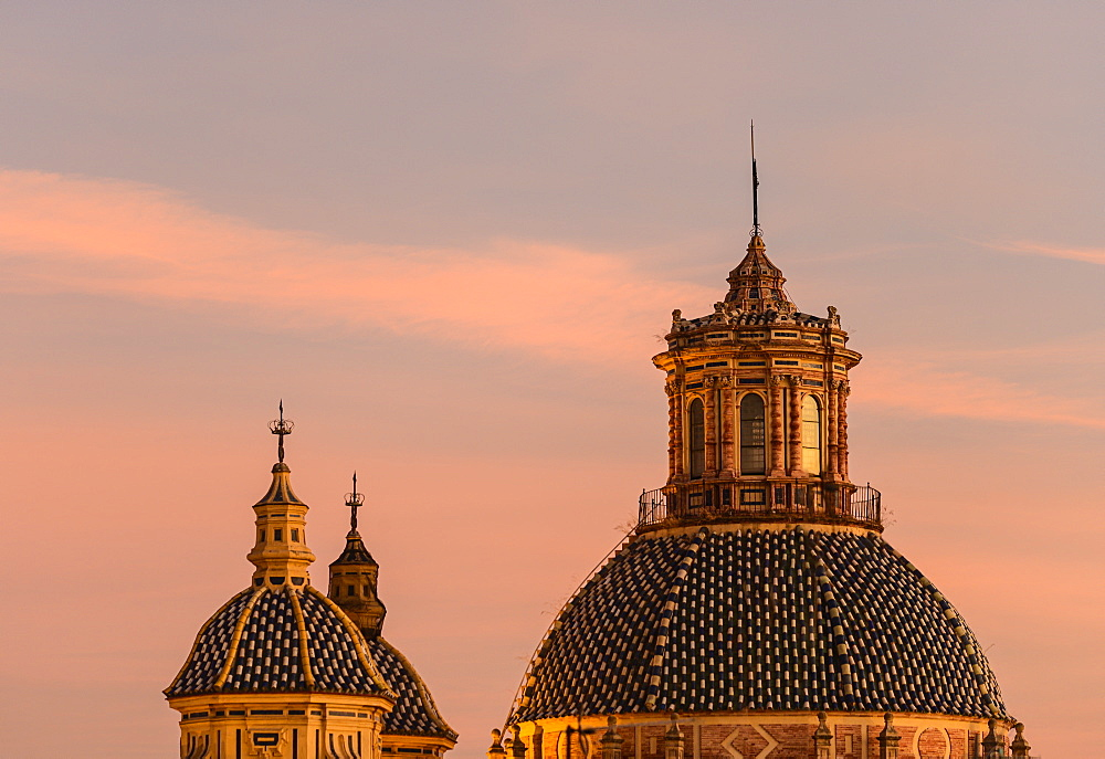 Domes of Church of Saint Louis of France at sunset in Seville, Andalusia, Spain