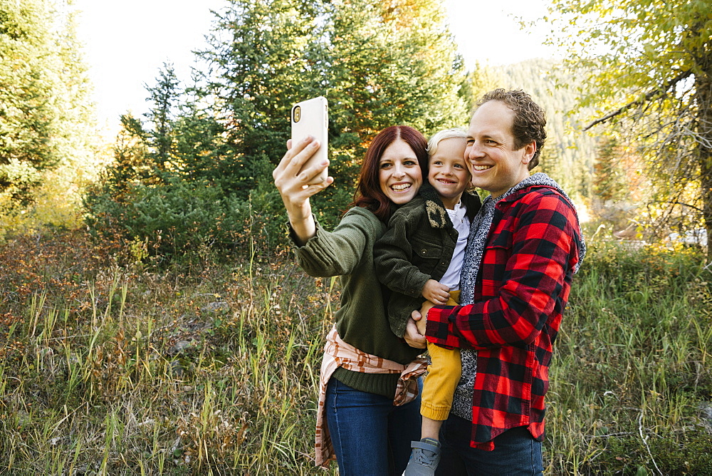 Family taking selfie in forest