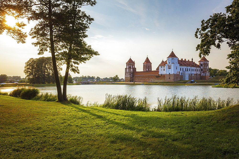 Lake by Mir Castle at sunset in Mir, Belarus