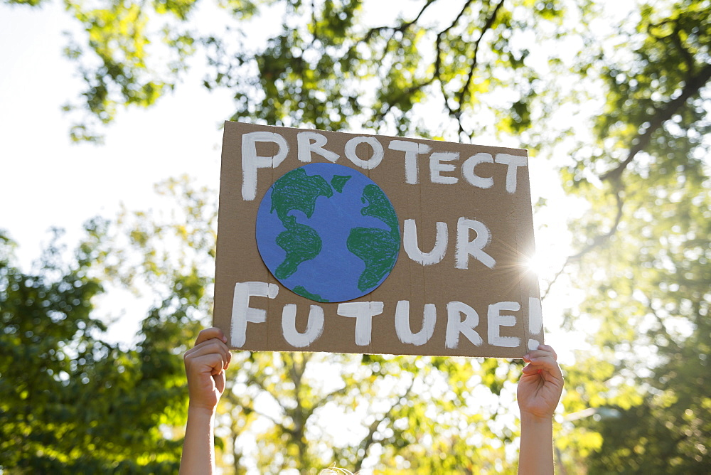 Climate change activist holding sign