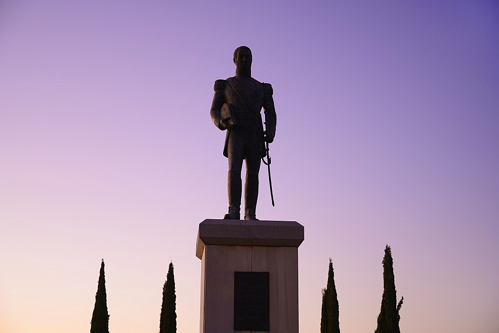 Silhouette of statue at sunset in Seville, Spain