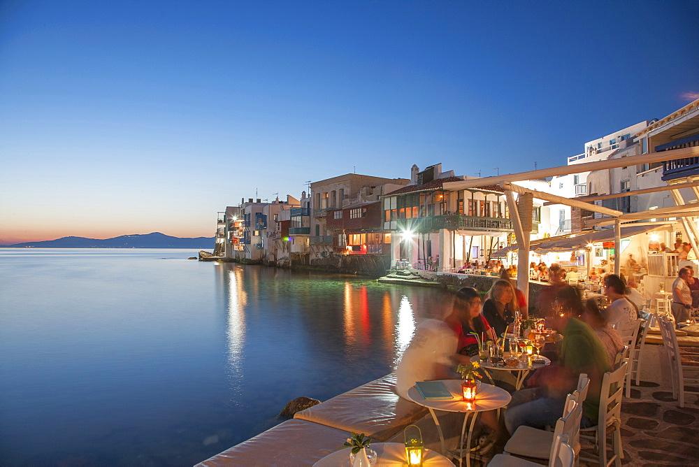 Waterfront restaurants at night in Mykonos, Greece