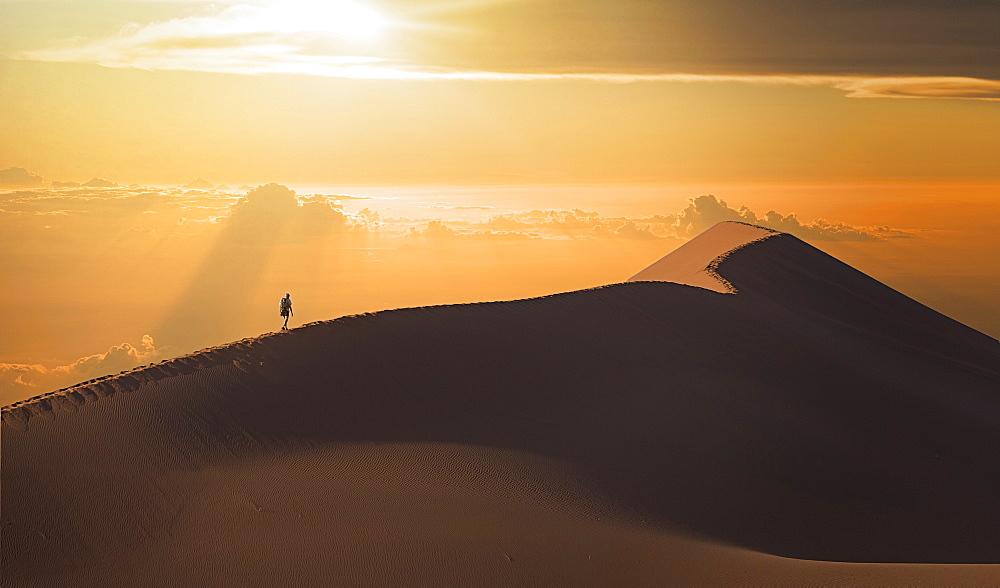 Man in desert in Namib Desert in Namibia