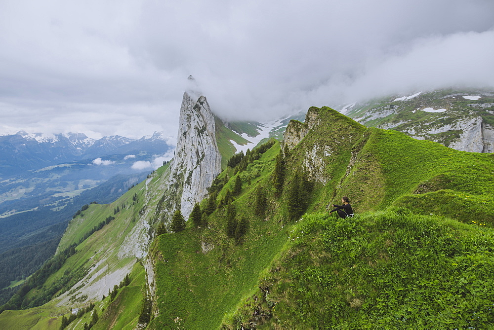 Woman sitting on mountain in Appenzell, Switzerland - 1178-28419