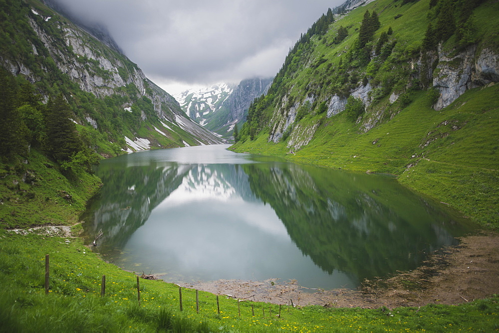 Lake in valley in Appenzell, Switzerland