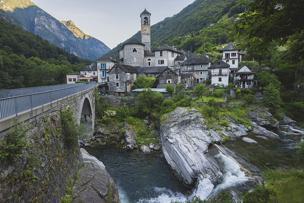 Bell tower by bridge and river in Ticino, Switzerland - 1178-28440