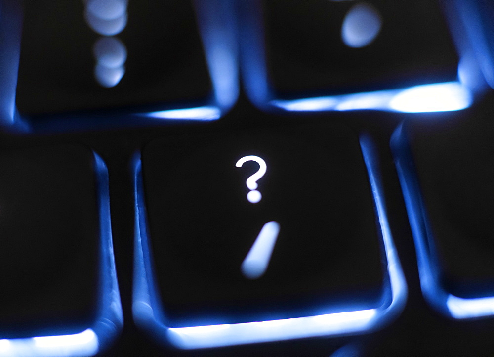 Illuminated question mark key on keyboard