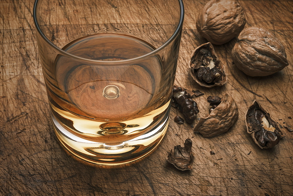 Drink in glass and walnuts