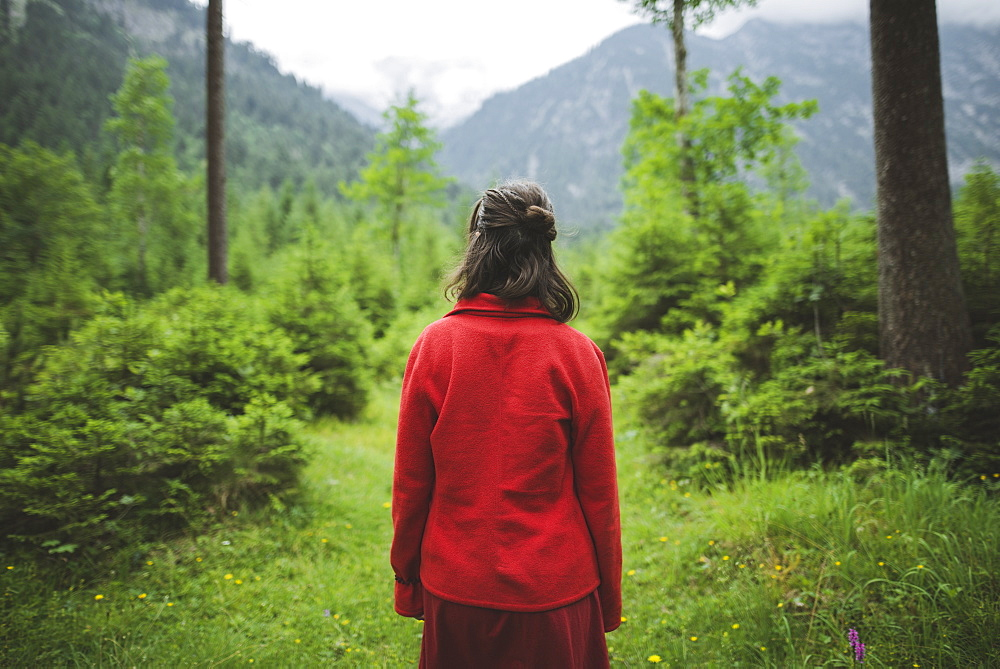 Young woman with red jacket in forest - 1178-28493