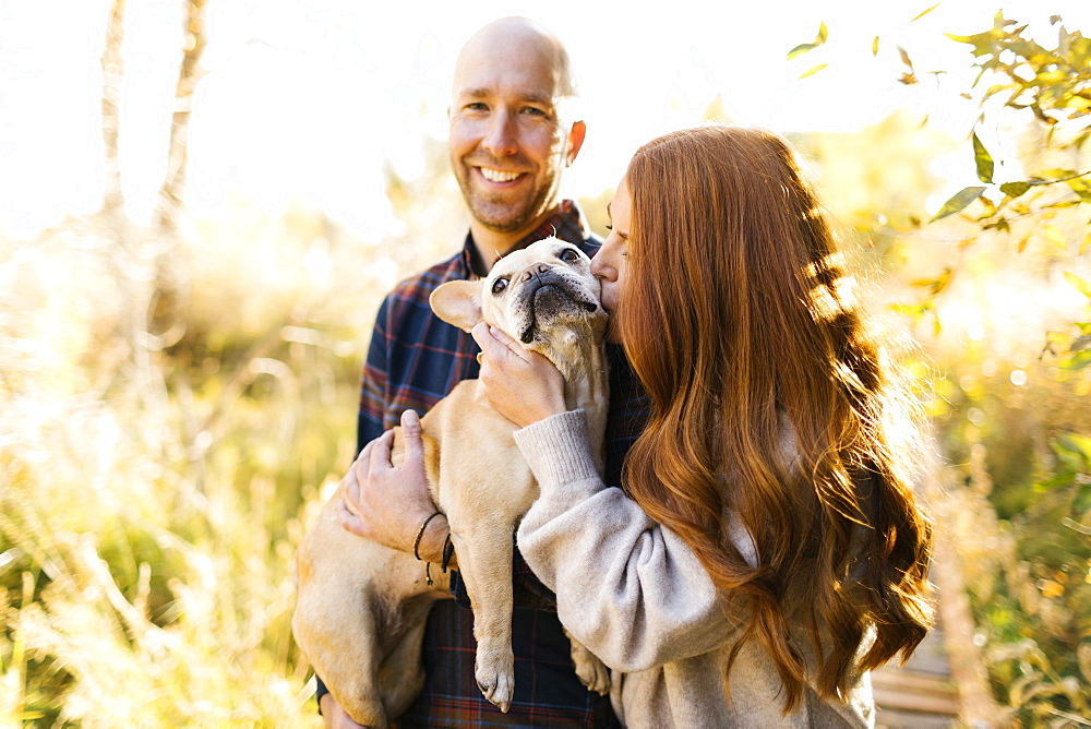 Couple with pet French bulldog in forest - 1178-28596