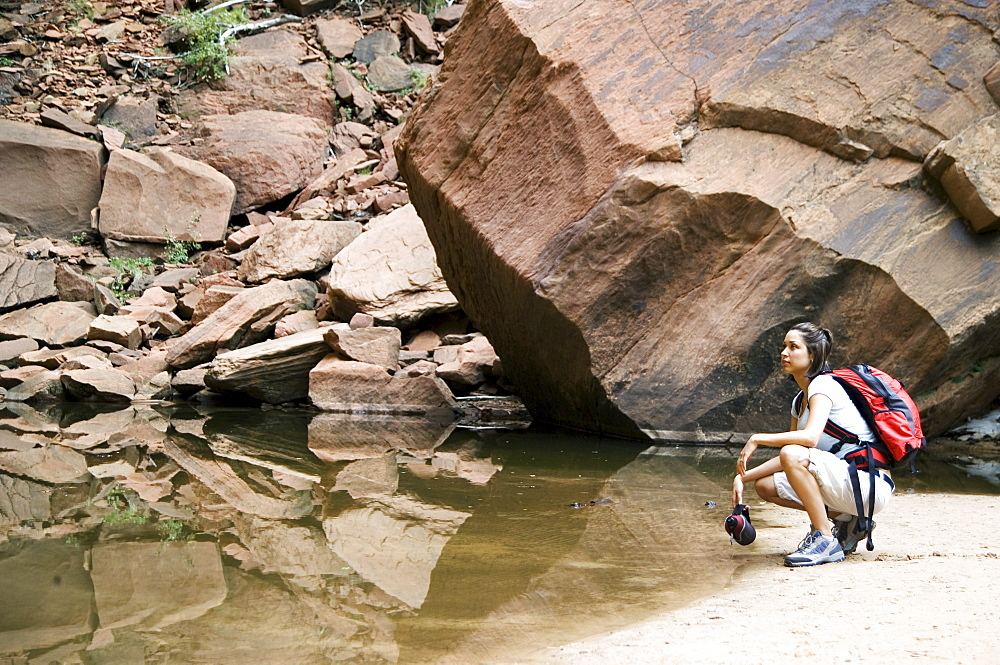 Female backpacker relaxing at a mountain lake