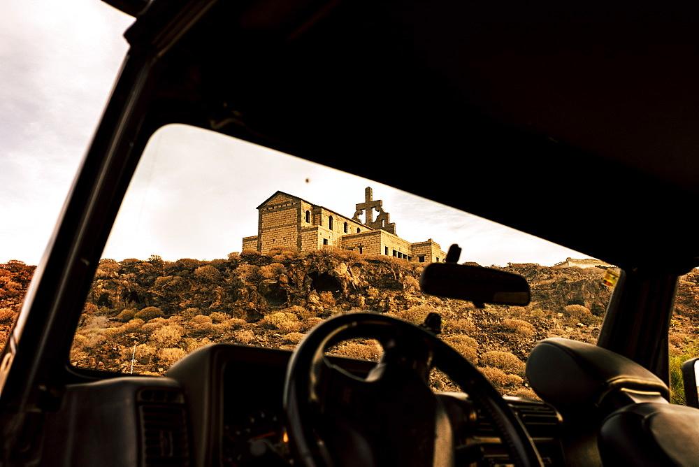 Abandoned church through car window in Tenerife, Spain