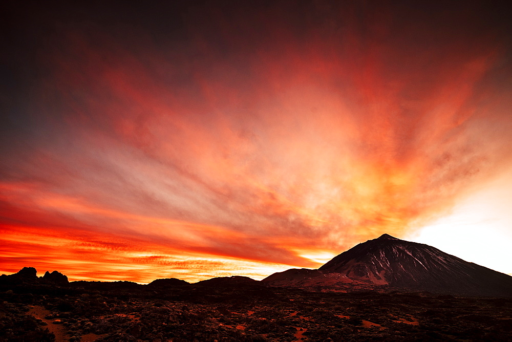 Mount Teide under clouds during sunset in Tenerife, Spain