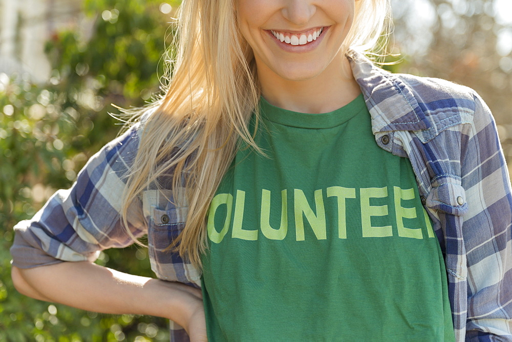 Woman in volunteer t-shirt