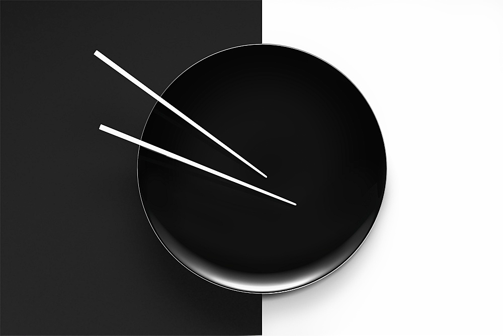 Empty plate with chopsticks