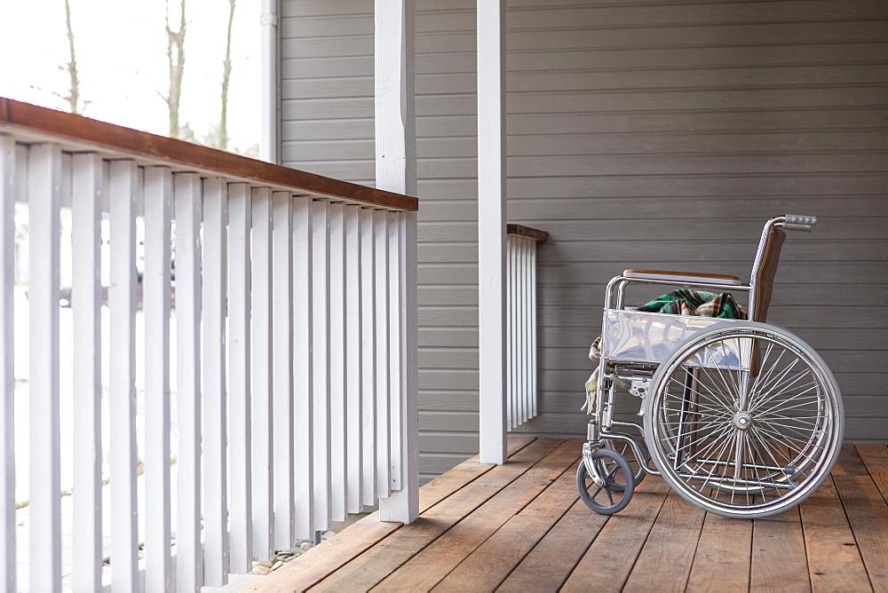 Empty wheelchairon porch