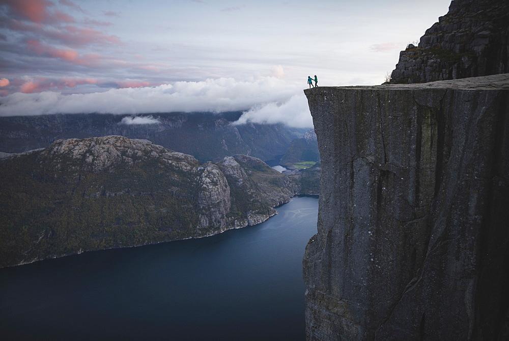 People standing on Preikestolen cliff in Rogaland, Norway