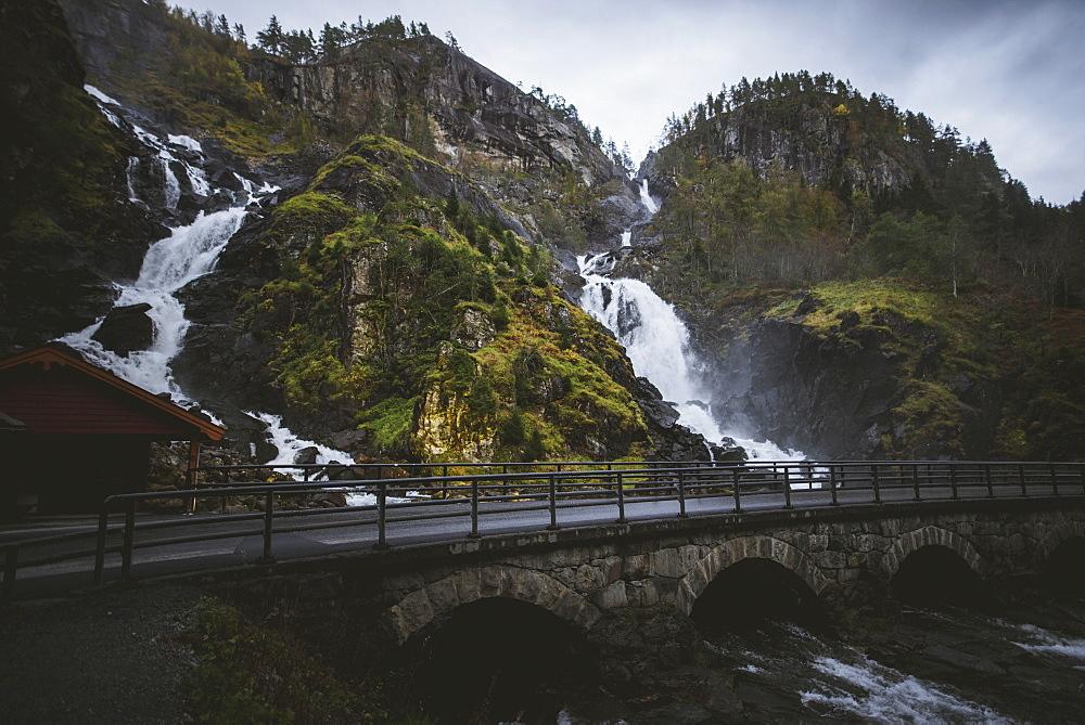 Road by Latefossen waterfall in Vestland, Norway