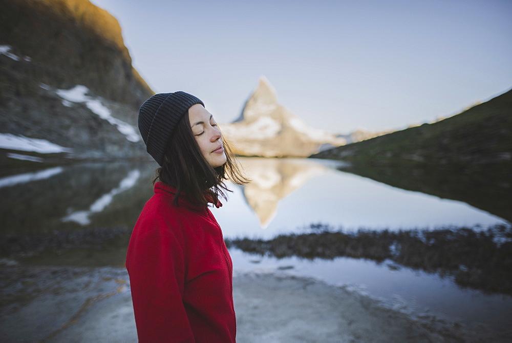 Woman standing by Matterhorn mountain and lake in Valais, Switzerland - 1178-28947