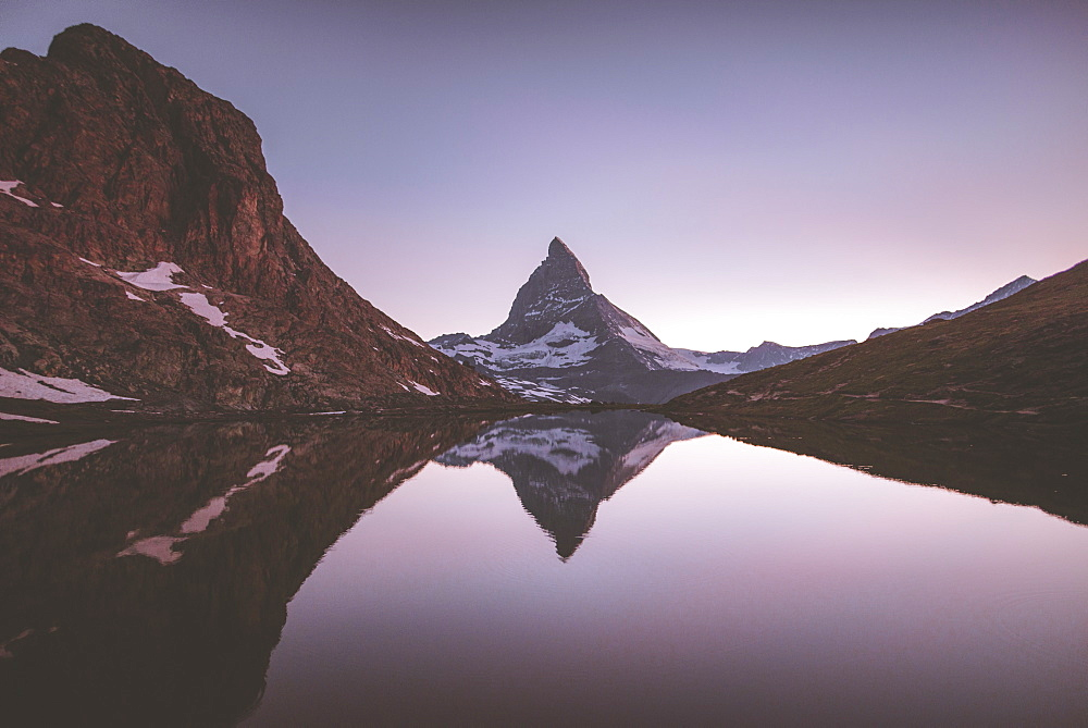 Matterhorn mountain and lake at sunrise in Valais, Switzerland