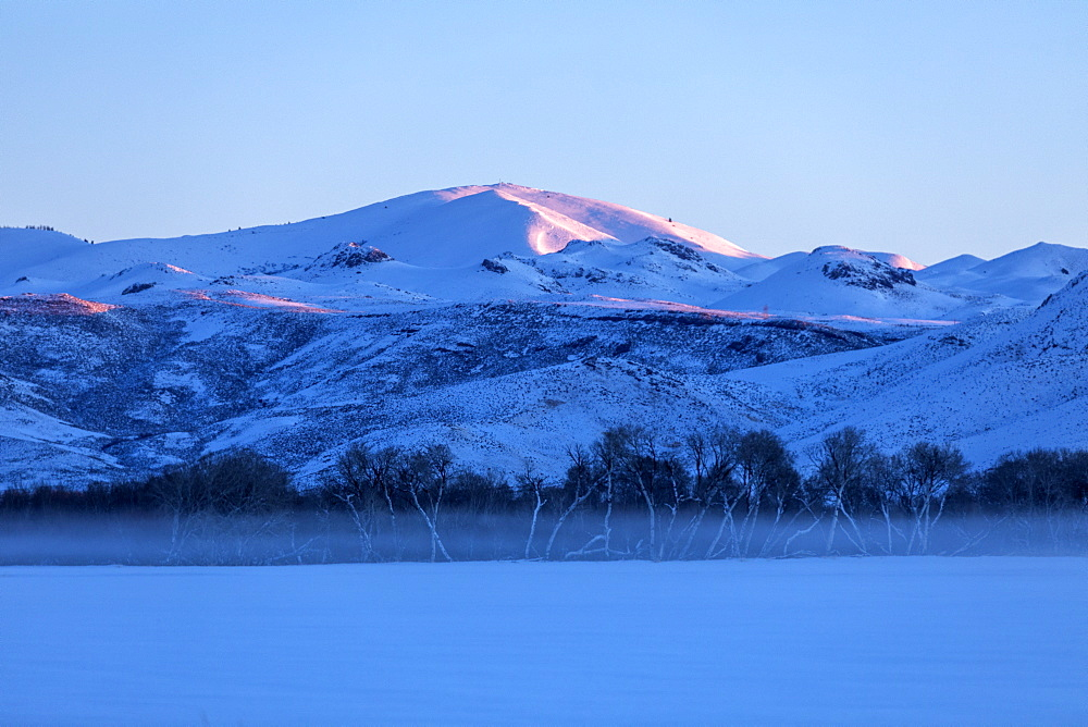 Snowy mountains at sunrise