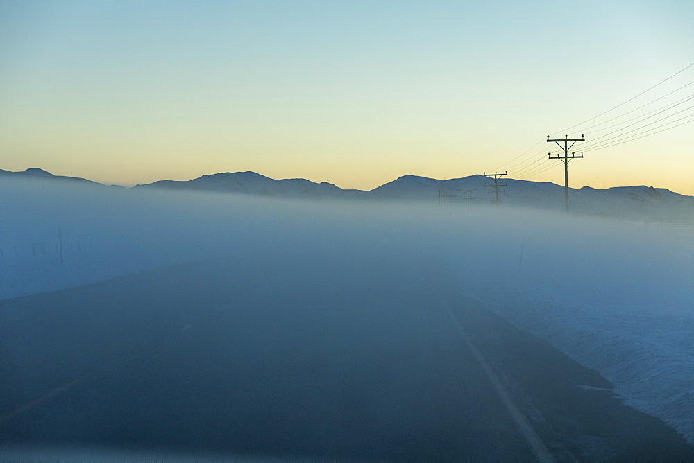 Road in fog at sunrise